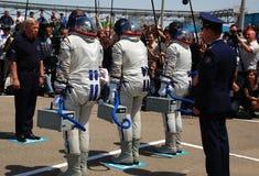 Reporting To The Chairman. Soyuz spacecraft crewmembers Robert Thirsk (Canada), Roman Romanenko (Russia) and Frank DeWinne (Belgium) are reporting to Mr.Perminov Royalty Free Stock Photography