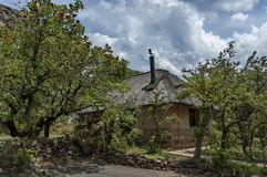 Repose house with thatch roof in KwaZulu-Natal nature reserve Royalty Free Stock Photo