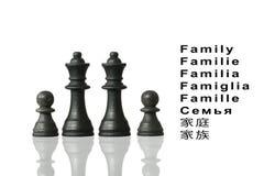 Représentation de la famille avec des pièces d'échecs et le mot Photographie stock
