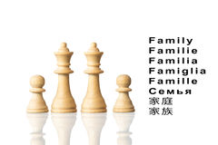 Représentation de la famille avec des pièces d'échecs et le mot Images stock