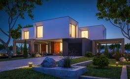 representación 3d de la casa moderna en el jardín en la noche imagen de archivo