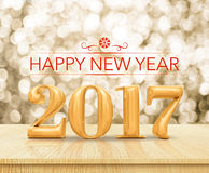 Representación 3d de la Feliz Año Nuevo 2017 del color rojo en la sobremesa de madera w Imagenes de archivo