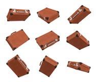 representación 3d de muchas maletas marrones del vintage en el estado cerrado que cuelga en el fondo blanco en diversos ángulos libre illustration