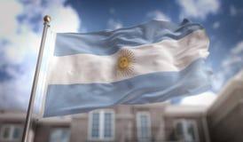 Representación de la bandera 3D de la Argentina en fondo del edificio del cielo azul imagen de archivo libre de regalías