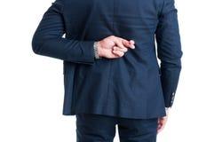 Representant- eller affärsmandanandefingrar korsade gest för bra lycka fotografering för bildbyråer