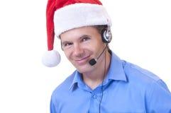 Representante del servicio de atención al cliente en el sombrero de Papá Noel Foto de archivo