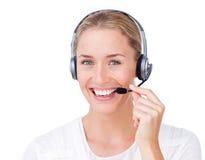 Representante del servicio de atención al cliente usando el receptor de cabeza Imagen de archivo