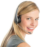 Representante/delegado de servicio de atención al cliente femenino feliz Wearing Headset fotos de archivo