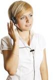 Representante hermoso del cliente con el SMI del receptor de cabeza Imagenes de archivo