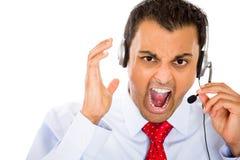 Representante irritado do serviço ao cliente Fotografia de Stock