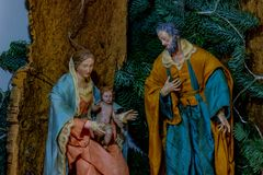 The representation of the holy family, The Virgin Mary holding the Child Jesus and beside St. Joseph. royalty free stock photo