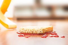 Representation of Murphy's law with a slice of bread fallen upside down. Concept representation of Murphy's law with a slice of bread fallen upside stock photo