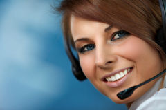 Representative call center woman with headset. Beautiful representative smiling call center woman with headset Royalty Free Stock Photo