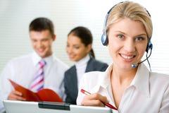 Representative operator. Portrait of representative operator with charming smile Stock Photos