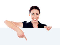 Representative pointing towards placard Stock Image