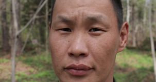 A representative of small and indigenous peoples of the far north - a Udege, looking directly at the camera.