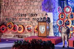 A representative of the townspeople gives a speech in honor of those who fallen at the ceremony in the Memorial Site To the Fallen. Nahariyya, Israel, April 17 stock photography