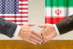 Representatives of the EU and Syria shake hands Stock Images