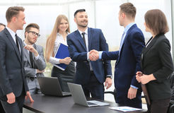Representatives of the two business teams greet each other. Handshake between representatives of the two business teams Royalty Free Stock Photo