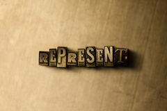 REPRESENTE - o close-up vintage sujo da palavra typeset no contexto do metal Fotografia de Stock Royalty Free
