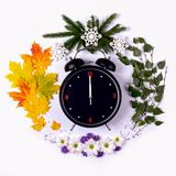 Representing the seasons of the year through the alarm clock and royalty free stock image