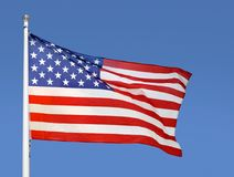 Representing the United States. Shot of the flag of the United States of America blowing in the wind Stock Images