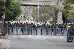 Repression. CARACAS, VENEZUELA - MARCH 16, 2014: State police blocking the passage of the protesters who claim for violations of human rights and the killing of Royalty Free Stock Photo