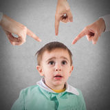 Reprimanded child. Frightened child shown by so many fingers stock images