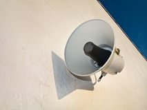 Repro loudspeaker. Power electric loudspeaker is on the white wall Stock Image