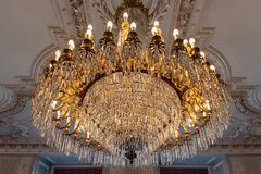 Reproduction of antique chandelier with crystals. Photo set with ancient objects royalty free stock photo