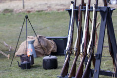 Reproduction vintage muskets at military camp fire. Reproduction vintage muskets at a military camp fire. Napoleonic war reenactment musket rifles. Selective royalty free stock photography
