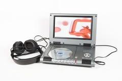 Reproductor de DVD con los auriculares Imágenes de archivo libres de regalías