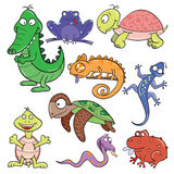Reptiles and amphibians doodle icon set. Hand-drawn cute cartoon reptiles and amphibians. Vector illustration Stock Images