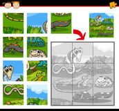 Reptiles education jigsaw puzzle game. Cartoon Illustration of Education Jigsaw Puzzle Game for Preschool Children with Reptiles and Amphibians Animals Royalty Free Stock Image