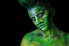 Reptilian Alien Girl. Fantastic Reptilian Girl. Creative Make up like Alien or Superhero Movie Stock Images