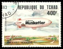 Balloons, Modern blimp. Republic of Chad - stamp printed in1983, Series manned flights, Balloons, Modern blimp royalty free stock image