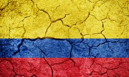 Republic of Colombia flag. Colombia flag on dry earth ground texture background royalty free stock image