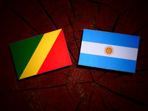 Republic of the Congo flag with Argentinian flag on a tree stump Royalty Free Stock Photos