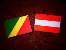 Republic of the Congo flag with Austrian flag on a tree stump is Royalty Free Stock Images