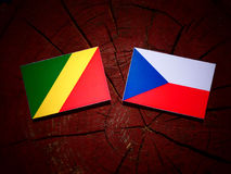 Republic of the Congo flag with Czech flag on a tree stump isola Stock Image