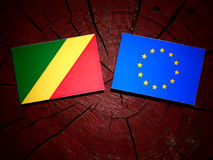 Republic of the Congo flag with EU flag on a tree stump isolated Stock Photography