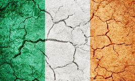 Republic of Ireland flag. On dry earth ground texture background stock image