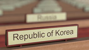 Republic of Korea name sign among different countries plaques at international organization. 3D rendering Stock Photography