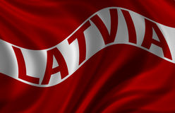 Republic of Latvia Flag. The Republic Latvia (Latvija) Flag billowing in the wind. On white Stock Photos