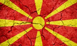 Republic of Macedonia flag. On dry earth ground texture background Stock Photo