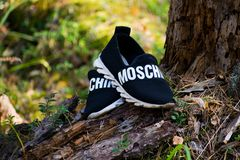 The Republic of Mari El, Russia - September 16, 2018 Men`s shoes, Moschino unisex shoes stock photo