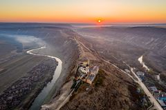 Republic of Moldova Old Orhei Monastery and Butuceni Village aerial view at sunrise royalty free stock images
