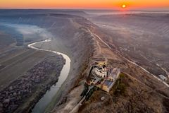 Republic of Moldova Old Orhei Monastery and Butuceni Village aerial view at sunrise royalty free stock image