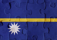 Republic of Nauru flag puzzle. Illustration of a flag of Republic of Nauru over some puzzle pieces. Its a JPG image Stock Image