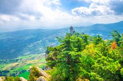Republic San Marino Terza Torre Montale third fortress tower with brick walls on Monte Titano. Stone rock with green trees, aerial top panoramic view of royalty free stock image